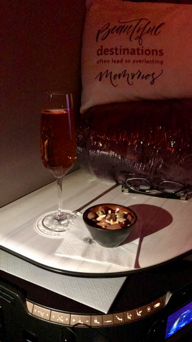 Qatar Airways Qsuite Business Class Lallier Grende Reserve Champagne pre-departure beverage and mixed nuts