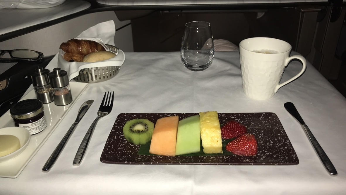 Qatar Airways Qsuite Business Class seasonal fruits and a cappuccino