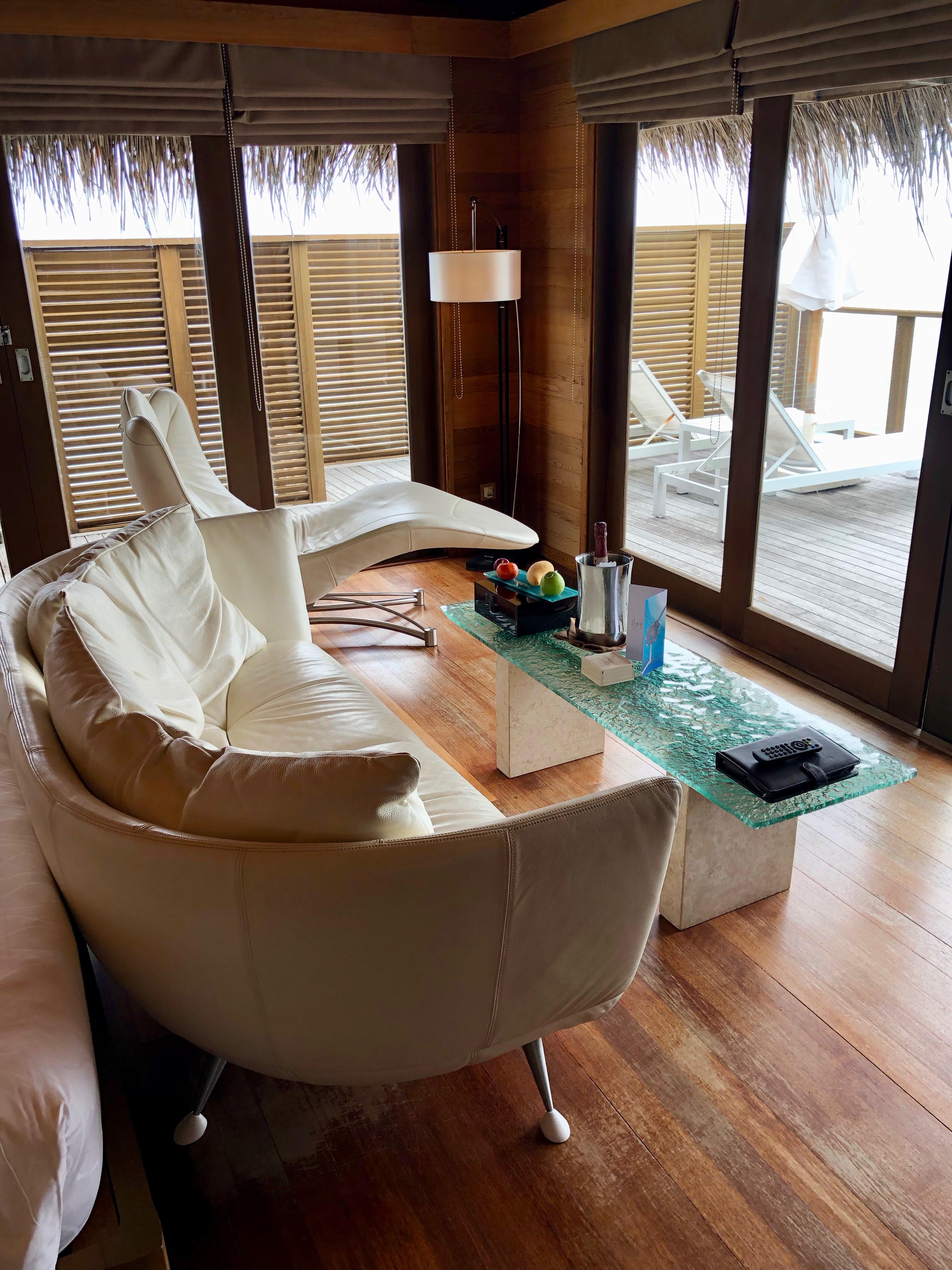 Conrad Maldives superior water villa indoor seating area