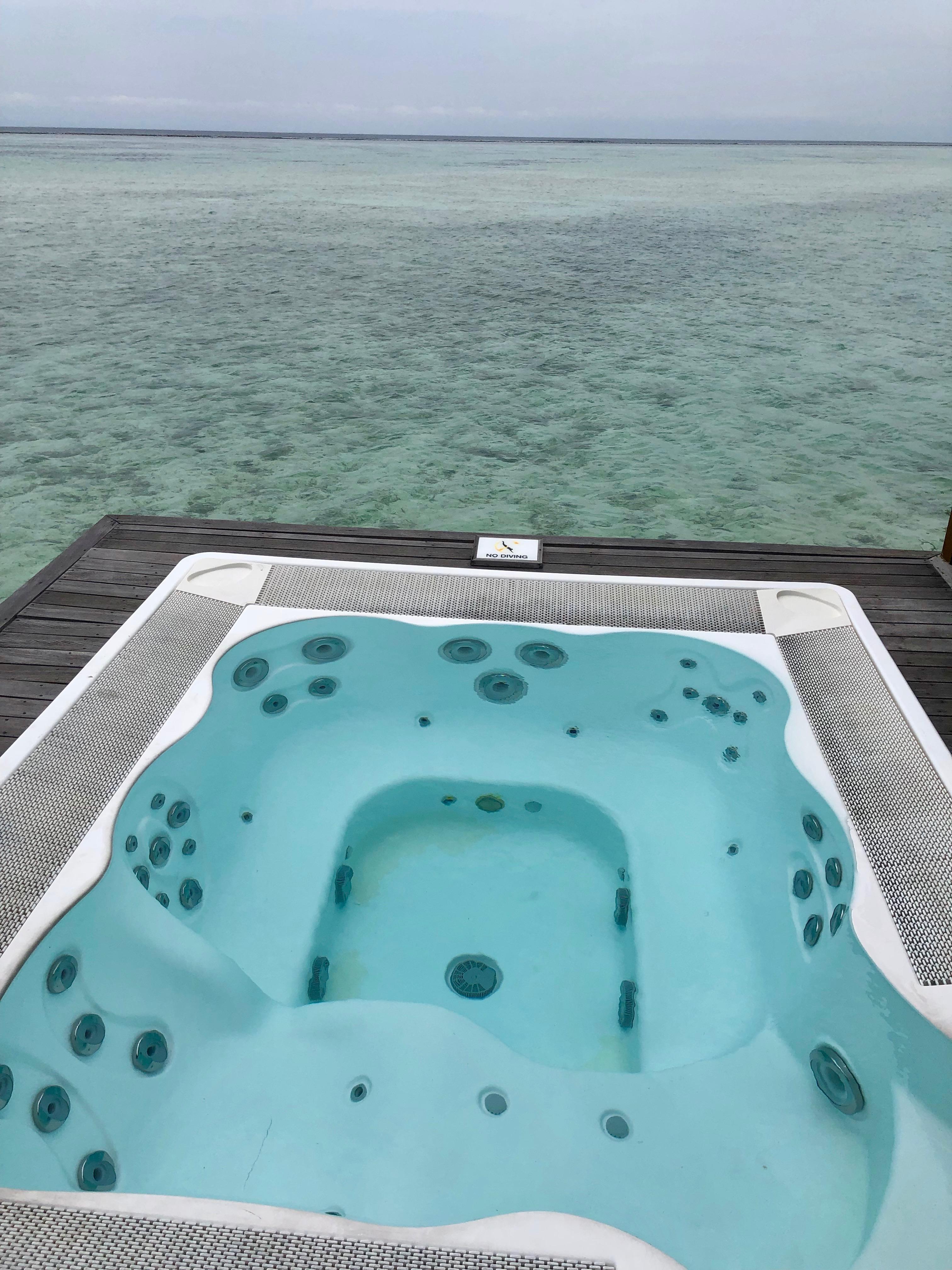 Conrad Maldives superior water villa overwater hot tub