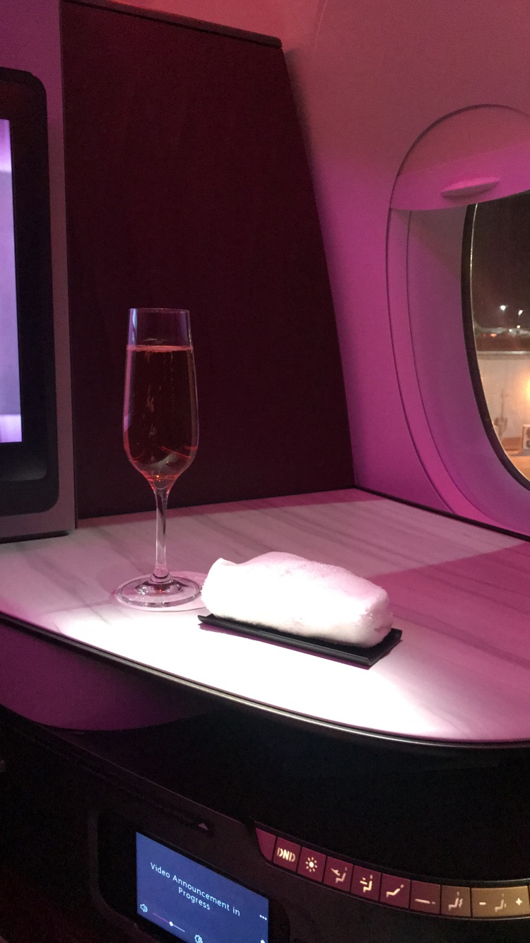 Qatar Airways Qsuite business class rosé champagne pre-departure beverage