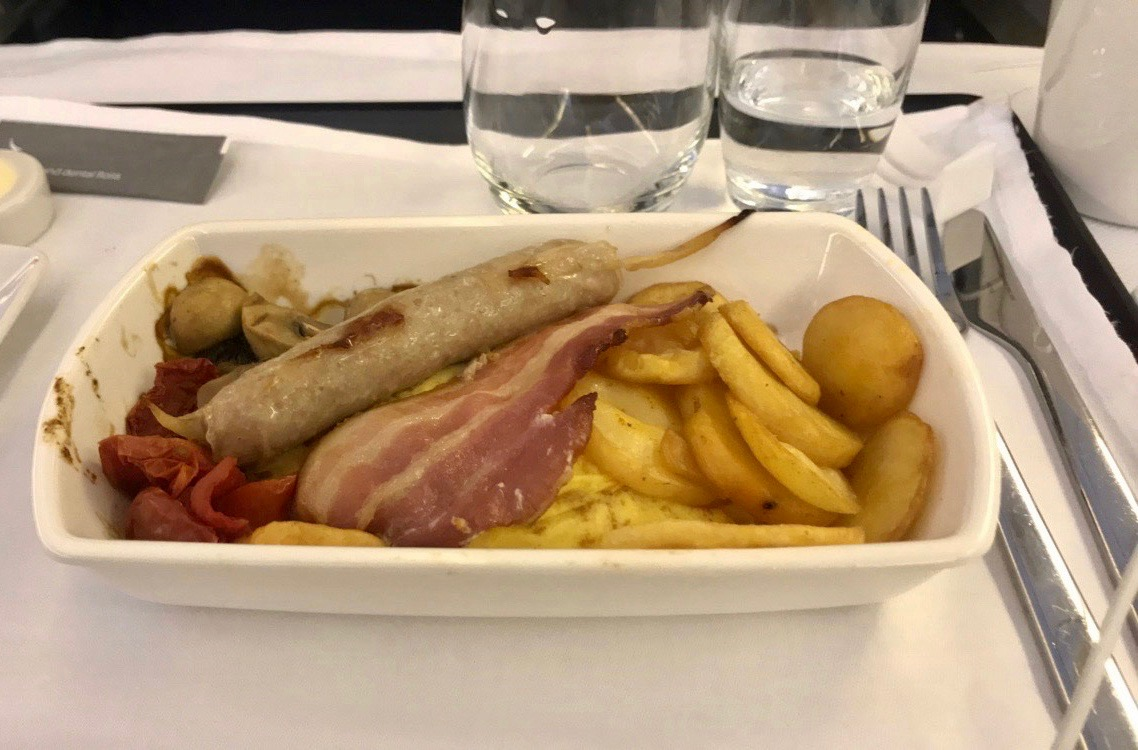 Cathay Pacific business class cheddar cheese omelette, Dingley Dell pork sausage, streaky bacon, oven dried tomato and lyonnaise potato