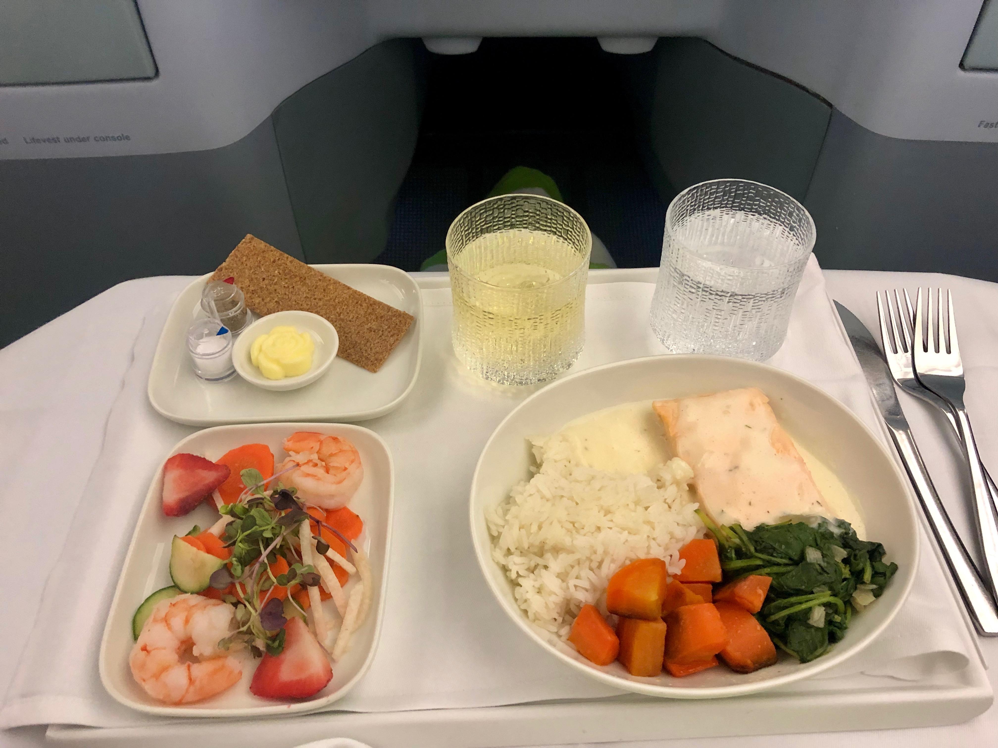 Finnair A330-300 JFK-HEL business class poached salmon with creamy lemon-dill sauce and Jasmine rice
