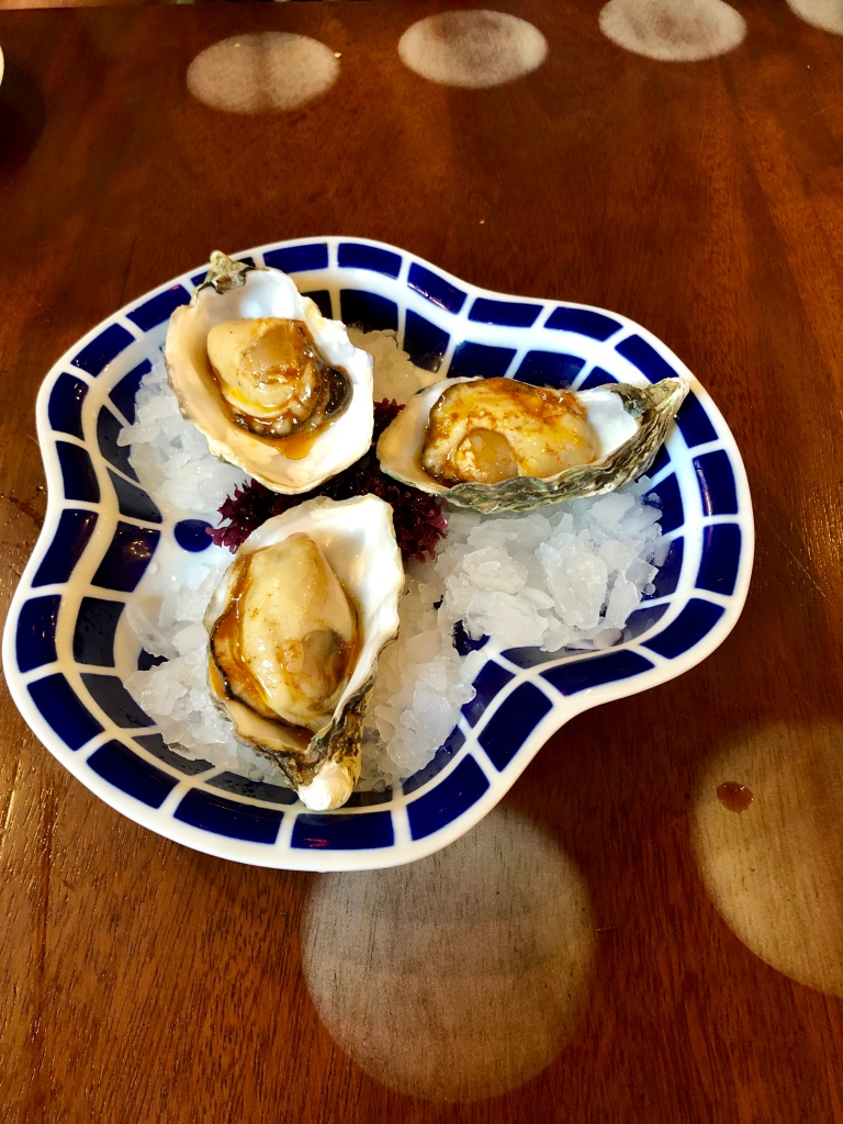 Tickets enigma oysters with red pickled escabeche sauce