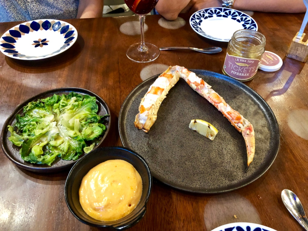 "Tickets king crab with ""ñora"" hot foam accompanied by charred lettuce and pickled fresh piparrak"