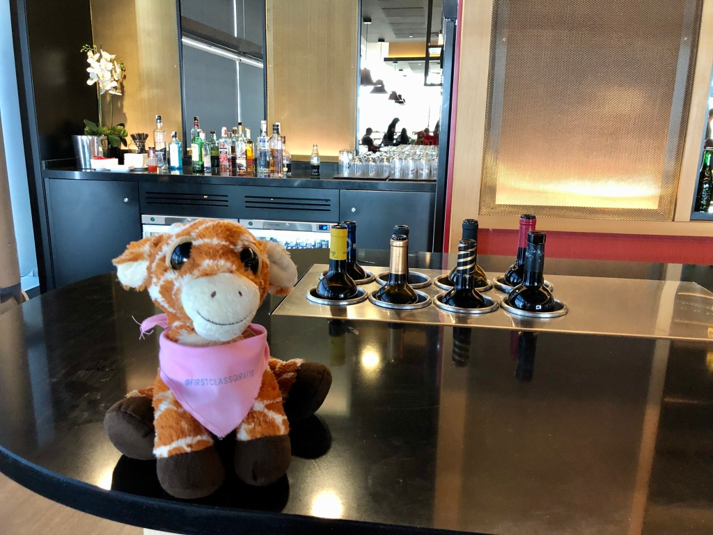 First Class Giraffe checking out the red wines