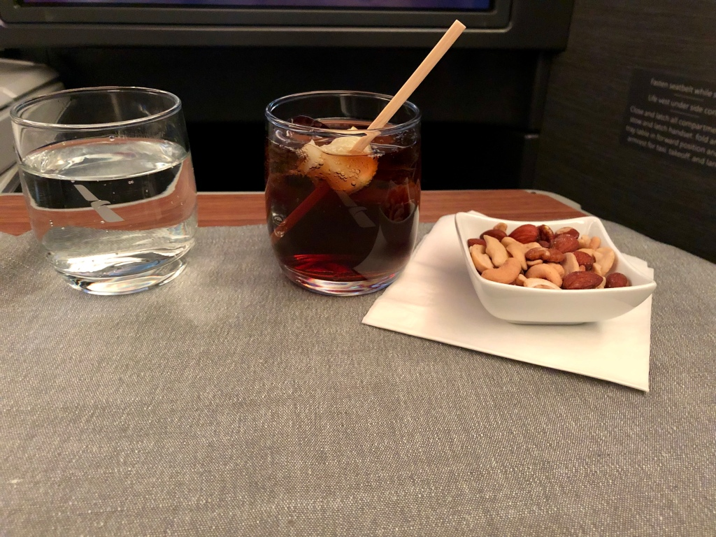 First drink service and warm mixed nuts