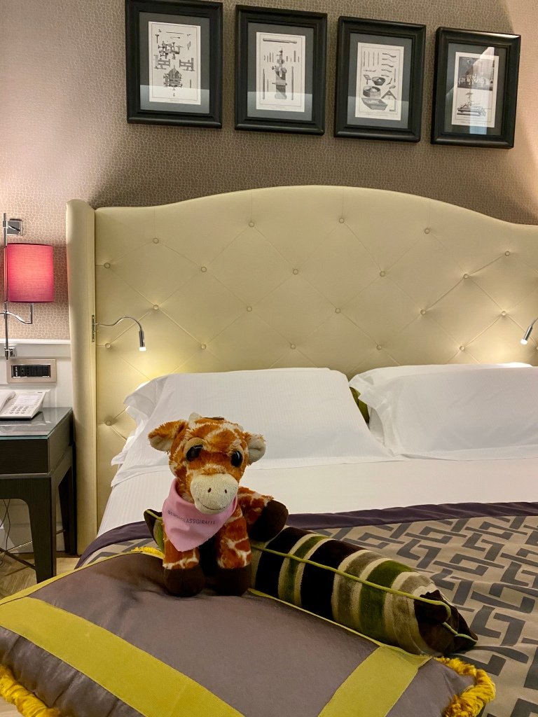 First Class Giraffe enjoying the king sized bed