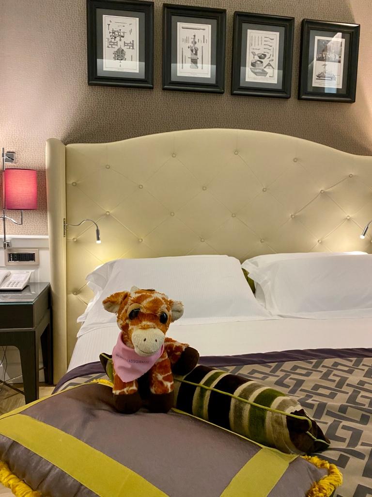 First Class Giraffe enjoying the king sized bed